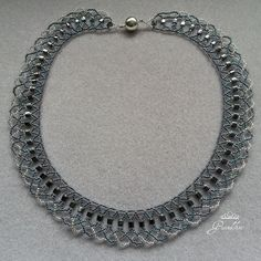 Gunmetal cube beads with blue & silver seed beads creating a lovely lace effect