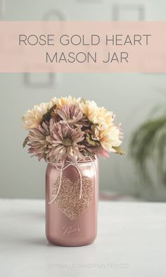 Gold Heart Painted mason Jar Rose gold painted mason jar with rose gold glitter heart and rim. Cute vase or wedding centerpieces.Rose gold painted mason jar with rose gold glitter heart and rim. Cute vase or wedding centerpieces. Wine Bottle Crafts, Mason Jar Crafts, Mason Jar Diy, Wedding Mason Jars, Sparkle Mason Jars, Mason Jar Centerpieces, Wedding Table Centerpieces, Wedding Decor, Centerpieces For Bridal Shower