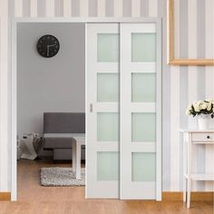 Deanta Twin Telescopic Pocket Coventry White Primed Shaker Doors - Frosted Glass.    #glassdoors  #telescopicdoors  #glasspocketdoors