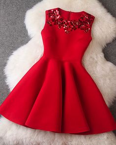 Gorgeous red dress to wear to a spring or summer party but with the white fur coat it makes it perfect for an autumn or winter party