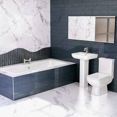 Add a subtle touch of darkness to your bathroom with black metro tiles. Combine with white marble-effect tiles to lighten up the look and create a stylish, elegant effect. . #wholesaledomestic #minimalisthome #darkinteriors #blackbathroom #marblebathroom #modernbathroom #moderninteriors #modernbathroomdesign #bathroommakeover #bathroominspiration #bathroomdecor #bathroomdesign