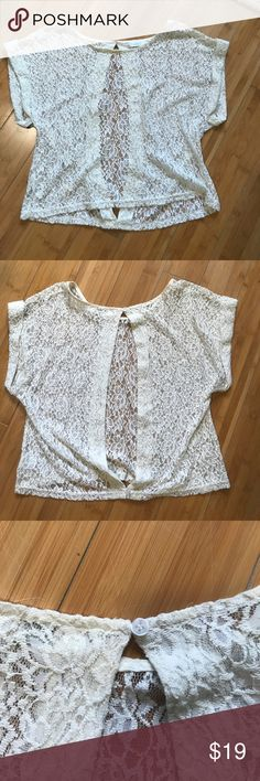 Cream lace top with open back Millau cream lace top with cute button detail and open back. Millau Tops Blouses