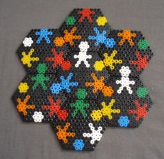 Cut idea by Therese; a puzzle made out of interchangeable hexagonal Hama tiles.