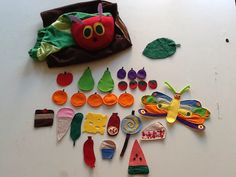 Very hungry caterpillar hand puppet with full set of things to eat
