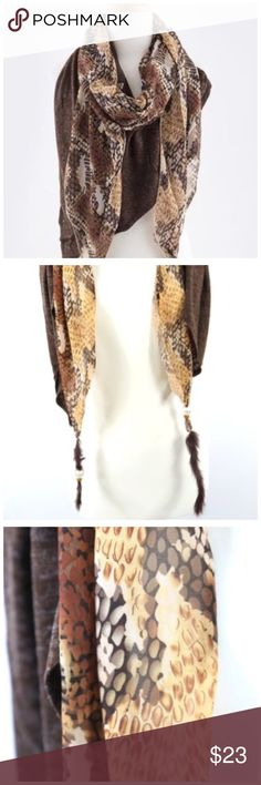 """B27 Reptile Print 2 Layer Stretch Feather Scarf ‼️ PRICE FIRM UNLESS BUNDLED WITH OTHER ITEMS FROM MY CLOSET ‼️    Absolutely gorgeous & stunning scarf.  Two part.  Shades of browns  reptile print on one part and a stretch blue heather fabric on the other.  Beading and a natural feather on each end.  Please check my closet for many more scarves and clothing items.  Length 42"""" Accessories Scarves & Wraps"""