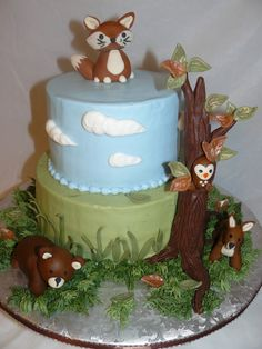 wilderness animal babies - 2 teir Baby shower cake made to match the theme of the baby's room. Baby bear, fox, fawn and owl are all made od fondant. The tree is hand sculpted from choc. candy clay.