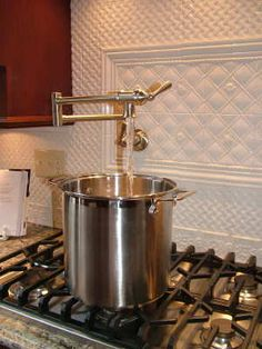 Check out this cool pot filler faucet right at the cooktop. You now only have to carry heavy pots of water one way. This model is from the ShowHouse collection by Moen. Beautiful Kitchens, Kitchen And Bath, Diy Pots, Commercial Kitchen, Pot Filler Faucet, Kitchen Faucet, Pot Filler, Faucet, Kitchen Pot