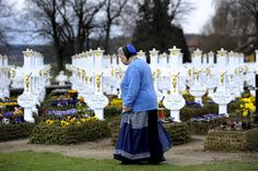 A woman dressed in traditional Sorb clothes passes tombs at the graveyard of Ralbitz, eastern Germany. Sorbs are an ethnic Slavic German minority located near the German-Polish border.    Matthias Rietschel/AP