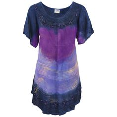 Feel as fresh and lovely as a starry night in our lightweight, short-sleeved tunic, washed with the painterly colors of a sunset bordered by an ink-blue twilight. To add to the twinkling, the neckline and rounded hem are embellished with swirls of e