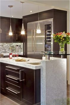 "Elegant Contemporary Kitchen by Anastasia Rentzos http://www.homeportfolio.com/Designers/Room/19623 Shows marble & glass ""L"""