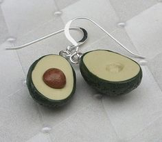 This is a nice, ripe pair of avocado earrings. One avocado earring half has the pit and the other earring half has the hole. The dark green skin is rough