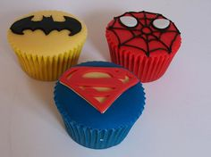Super hero cupcakes - Spiderman, Superman, Batman.  Looks like fondant, but I think you can use  regular frosting for the top and just cut out the design with the fondant.