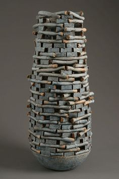 Blue Keep, Jim Kraft, Seattle— His pieces look like they're constructed from small blocks and sticks of clay, almost like building a brick wall.