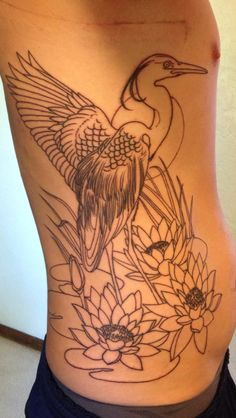 My new tattoo. Great Blue Heron standing guard over 3 Lilys, which represent my 3 beautiful girls. I can't wait to get color.