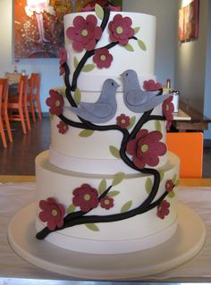 White Cake with Maroon Flowers, Olive Leaves & Gray Pair of Birds
