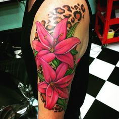 60 Colorful Lily Flower Tattoo - Designs & Meaning Check more at http://tattoo-journal.com/40-colorful-lily-tattoos/