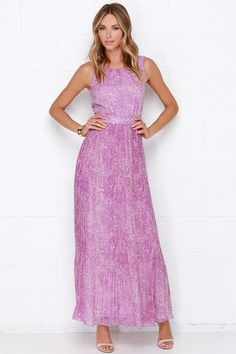 Whimsical yet cultivated, the Darling Nicole Purple Maxi Dress is charming beyond belief! Bright purple and blush print chiffon falls into a darted sleeveless bodice with a banded waist, as well as a finely pleated maxi skirt. Back keyhole fastens with a rhinestone button. Hidden back zipper. Fully lined. 100% Polyester. Machine Wash Cold. Imported.