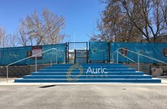 Auric Solar logo on the stairs I painted