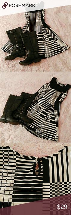 Black and White Dress Blk & wht sleeveless 👗. I'm 5'2 and the bottom of it falls right above my knee. It ties in the back. The tighter it's tied, the smaller your waist becomes. Great with a pair of knee high boots or a pair of black wedges or flip flops. You can dress it up or down. Great for a romantic dinner date or for a day at the office. This is one of my favs. When you put it on, you'll know why! New Directions Petite Dresses Asymmetrical