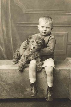 Antique photo of a boy and his dog.