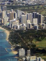 Southeast Waikiki hotels between Kapiolani Park (front) and the Ala Wai Golf Course (behind) as seen from a Hawaiian Airlines flight to Maui.