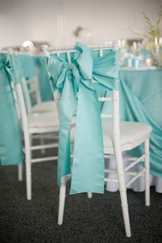Simple white wooden wedding chairs made beautiful with this Tiffany Blue bow and sash - Blue Maryland Wedding Chair Ties Meaghan Elliot Photography Chesapeake Bay Wedding Reception: Kelly + Robert Tiffany Blue Party, Tiffany Blue Weddings, Tiffany Theme, Tiffany Wedding, Aqua Wedding, Wedding Rustic, Trendy Wedding, Wedding Reception Chairs, Chair Ties