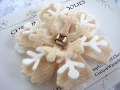 Felted snowflake pin with jingle bell