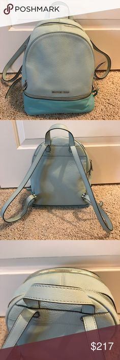 NWOT Michael Kors Rhea Medium Blue Zip Backpack New without tags- never used & comes with original care card. Dust bag not included. Gorgeous purse! See photos form Measurements. Offers welcome through the offer button. Michael Kors Bags Backpacks