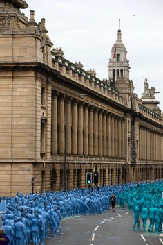 "Naked volunteers, painted in blue to reflect the colours found in Marine paintings in Hull's Ferens Art Gallery, prepare to participate in US artist, Spencer Tunick's ""Sea of Hull"" installation in Kingston upon Hull on July 9, 2016. Over a period of 20 years, the New York based artist has created over 90 art installations in some of the most culturally significant places and landmarks around the world including the Sydney Opera House, Place des Arts in Montreal, Mexico City, Ernest Happel…"