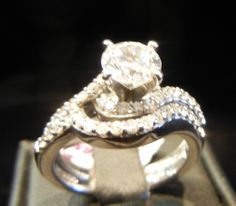 A Signature Piece from A.Jaffe, Two Ring Round Cut Diamond Engagement #100265