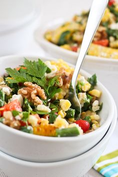 """Grill Roasted Corn Salad - The Healthy Foodie    8 ears of fresh corn on the cob, silk removed 1 red bell pepper, chopped 1 cup grape tomatoes 2 cups haricots verts, ends removed and cut into 1"""" pieces 1 cup fresh parsley, chopped 1 large jalapeno pepper, seeded and very finely chopped the juice of 1 lime 1 tsp Himalayan salt ½ tsp freshly cracked black pepper 75g unripened goat cheese, crumbled ½ cup walnuts, chopped"""