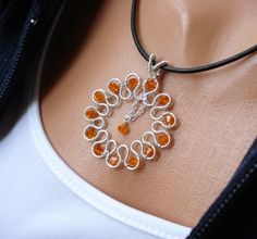 LIFE COLLECTION Sunburst Sterling Silver Wire Wrapped Pendant Necklace, beadinggem via Etsy.