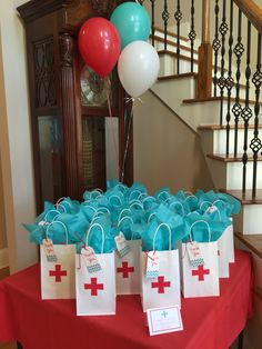 I cut crosses out of construction paper then glued to the little bags and put a mini first aid kit in each bag as a thank you gift !