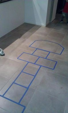DIY hopscotch at home - blue painting tape
