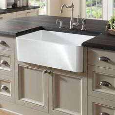 Bring a taste of country-style indoors with this farmhouse kitchen sink from Somette. This Sutton white kitchen sink offers sustainability and long-lasting qualities with its sturdy Fireclay construction. White Kitchen Sink, Apron Sink Kitchen, Farmhouse Sink Kitchen, Kitchen Shelves, Diy Kitchen, Kitchen Decor, Kitchen Sinks, Kitchen Ideas, 10x10 Kitchen