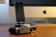 Here's a neat way to recycle your old film cameras- Charge your iPhones and iPods with this unique dock made from a vintage film camera, now buyable from Etsy.    http://www.digitaltrends.com/lifestyle/heres-a-neat-way-to-recycle-your-old-film-cameras/