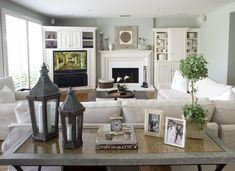 Love this living room set up... Kinda like ours- I like the baskets by the fireplace
