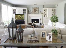 Love this living room set up... Kinda like ours- I like the baskets by the fireplace