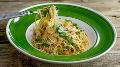 Garlic and Lemon Spaghetti Recipe.  Don't skip the fresh herbs, cheese & remaining garlic chips.
