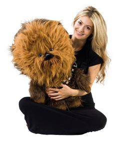 Cuddly and courageous, this extra-large Chewbacca plush toy features an oh-so-hug-worthy body and giant head. Give him a squeeze and listen as he lets out a fearsome Wookiee roar. 24'' HPolyester / cottonRequires three LR44 batteries (included)Recommended for ages 3 years and older