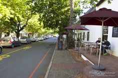 The oak canopied Andringa Road in Stellenbosch: The old buildings, tree-lined streets, and plethora of restaurants and coffee shops make Andringa Road, and its surrounding areas, a great place to have an early morning photo walk or coffee pitstop.