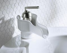 Various shapes and textures give this all-white grooming space a sense of depth. Hexagon Tiles, Tile Patterns, Home, Plumbing, Bathroom Faucets, Remodel, Kohler, Sink, Hexagon