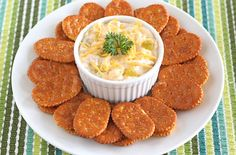 Nacho Chicken-Cheese Spread  -  INGREDIENTS: 1 cup shredded Cheddar or Monterey Jack cheese; 1 cup shredded, cooked chicken; 1 cup reduced-fat sour cream; 1 tablespoon taco seasoning mix; 1/2 cup canned corn, drained; 1 can (4 oz.) chopped green chili peppers, drained; Keebler® Town House® Flipsides® Original crackers