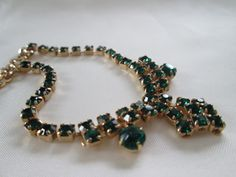 Dark Green Rhinestone Bib Necklace and matching earrings at Blue Pearl Vintage