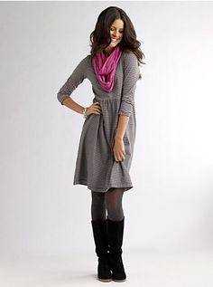 A cozy sweater dress paired with tights & knee boots is always a great look for work or a night out. Add a fun scarf & you are set!