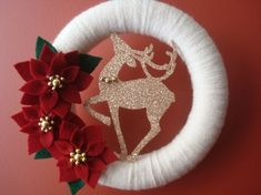Yarn Christmas Wreath with Red Felt Poinsettias and a glittered Golden color Reindeer Door Decoration-10 in wreath