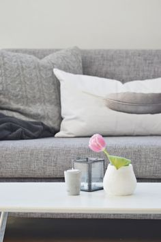 I would love a grey, tan, or even a black couch. I think grey is really pretty and compliments every accent color.