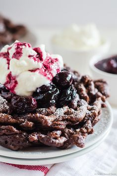 Black forest funnel cake - a delicious chocolate funnel cake with cherry compote, and fresh whipped cream
