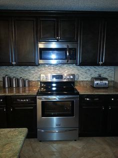 Dark brown kitchen cabinets the home depot chocolate for Kitchen cabinets johnson city tn