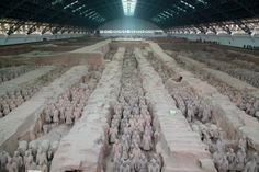 About 8,000 Terracotta Warriors, which are life-size statues of infantryman, cavalry, archers, charioteers and generals, were buried in three pits less than a mile to the northeast of the mausoleum of Qin Shi Huangdi, the first emperor.~~tko